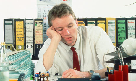 Man bored at work in office